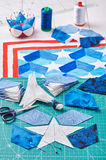 Sewing of quilt with stylized elements of American flag Royalty Free Stock Photo