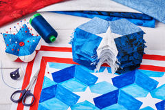 Sewing of quilt with stylized elements of American flag Stock Image