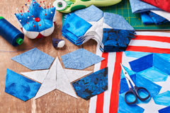 Sewing of quilt with stylized elements of American flag Royalty Free Stock Images