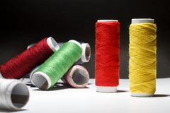Sewing Quilting Thread, Rainbow colors. on black background with place for your own text.  Royalty Free Stock Photography