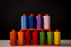 Sewing Quilting Thread, Rainbow colors. Isolated on black background with place for your own text Stock Images