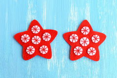 Sewing red Christmas star ornament. Sew the white felt circles to the red felt stars using red thread. Step. Top view. Closeup Royalty Free Stock Images