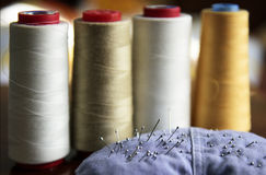 Sewing rolls and needles Royalty Free Stock Photos