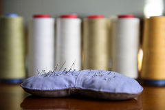 Sewing rolls and needles Stock Photos