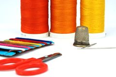Sewing set. With scissors,thimble,needdles and spools Stock Images