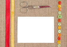 Sewing set background. With ribbon, scissora and button Stock Images