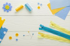 Sewing set fabrics and threads on wooden table Stock Photo