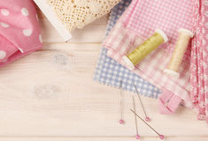 Sewing set: fabrics and threads Stock Photo