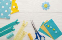 Sewing set fabrics and threads on wooden table Stock Photos