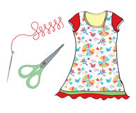 Sewing set with needle, scissors and dress Royalty Free Stock Photos