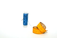 Sewing set: Thread and measuring tape Royalty Free Stock Images