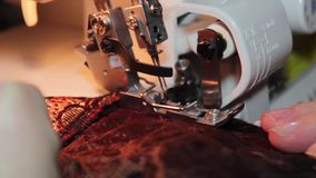 Sewing on the sewing machin stock video footage