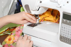 Sewing by the sewing machine Royalty Free Stock Photos