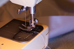 Sewing with a sewing machine Royalty Free Stock Photo