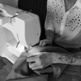 Sewing with a sewing machine royalty free stock image