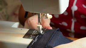 Sewing on the sewing machine stock video