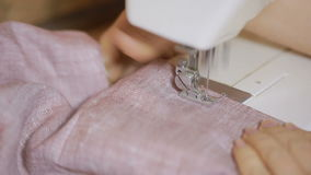 Sewing on the sewing machine, closeup. woman`s hand seamstress stock video
