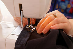 Sewing on the sewing machine Royalty Free Stock Image