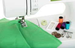 Sewing on the sewing mashing and sewing supplies Stock Images