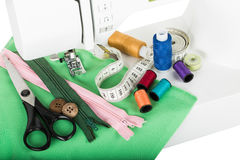 Sewing on the sewing mashing and sewing supplies Royalty Free Stock Image
