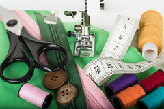 Sewing on the sewing mashing and sewing supplies Royalty Free Stock Images