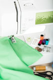 Sewing on the sewing mashing and sewing supplies Royalty Free Stock Photos