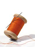 Sewing spool with a needle. A sewing needle. Royalty Free Stock Image