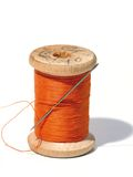 Sewing spool with a needle. A sewing needle. royalty free stock photography