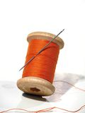 Sewing Spool With A Needle. A Sewing Needle. Stock Photo