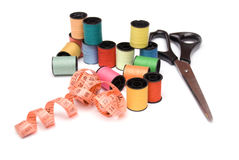 Sewing spools, cantimeter and scissors Royalty Free Stock Image
