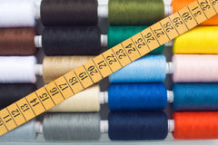 Sewing spools and meter. Closeup of multicolored sewing spools and meter Stock Image