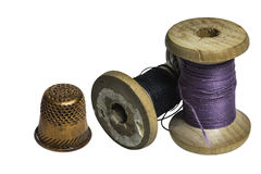 Sewing spools with thread and thimble Royalty Free Stock Photos
