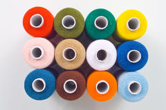 Sewing spools on white background. Colored sewing spools on white background Royalty Free Stock Images