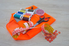 Sewing still life: colorful cloth. scissors and sewing kit includes threads of different colors, thimble and other sewing accessor Royalty Free Stock Photography