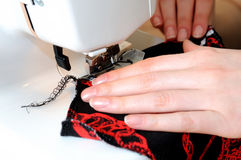 Sewing on the stitching machine Royalty Free Stock Photography