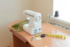 sewing studio with sewing machine on table royalty free stock image