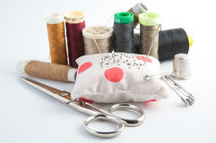 Sewing stuff. Scissors, thimble, thread, etc. on a white background Royalty Free Stock Images