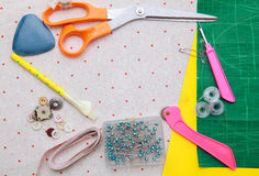 Sewing stuff on fabric pattern Stock Photography