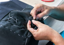 Sewing suits , tailoring by hand Stock Photo