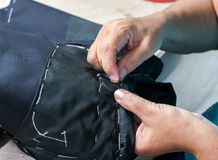 Sewing suits , tailoring by hand Stock Image