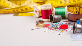 Sewing supplies. Measuring tape, thread, pins, buttons and thimbles Royalty Free Stock Image