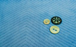 Sewing supplies and accessories for needlework. Fabric, spools of thread on blue background. royalty free stock photography
