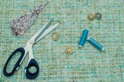 Sewing supplies and accessories for needlework. Fabric, spools of thread, scissors and thimbles on white background. stock photo
