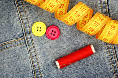 Sewing supplies on denim Stock Photo