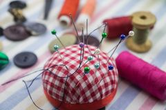Sewing supplies scattered on the table stock image