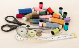 Sewing supplies, threads, needles, thimble, scissors Stock Images