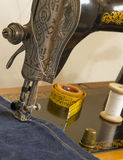 Sewing supplies on the vintage sewing mashine. Royalty Free Stock Photo