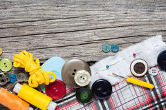 Sewing Supplies. On Wood Background Stock Image