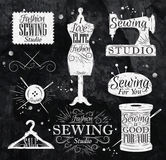 Sewing symbol chalk. Sewing symbol in retro vintage in chalk lettering mannequin, coil, pins, hangers, buttons Royalty Free Stock Photo