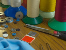 Sewing table with needles and thread royalty free stock photo